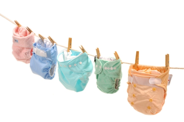 cloth nappies drying on a washing line